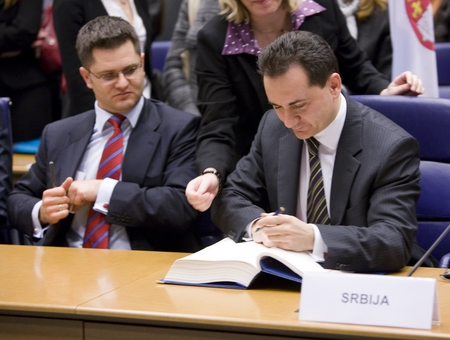 The signing of Stabilisation and Association Agreement (SAA) between the EU and Serbia: Serbian Foreign Minister Vuk Jeremic (L) and Serbia's chief negotiator with the EU Božidar Djelić