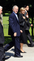American President George W. Bush accompanied by Chief of Protocol of the Republic of Slovenia Ksenija Benedetti